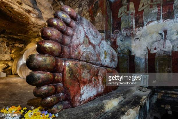 statue of a reclining buddha - jeremy chan stock pictures, royalty-free photos & images