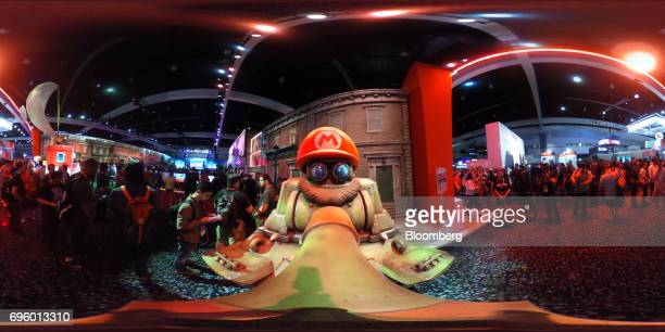 A statue of a tank wearing the hat and mustache of Nintendo Co video game character Mario sits on display at the company's booth during the E3...