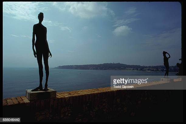 A statue of a thin woman on the balistrade This is at the chateau where Picasso had his studio