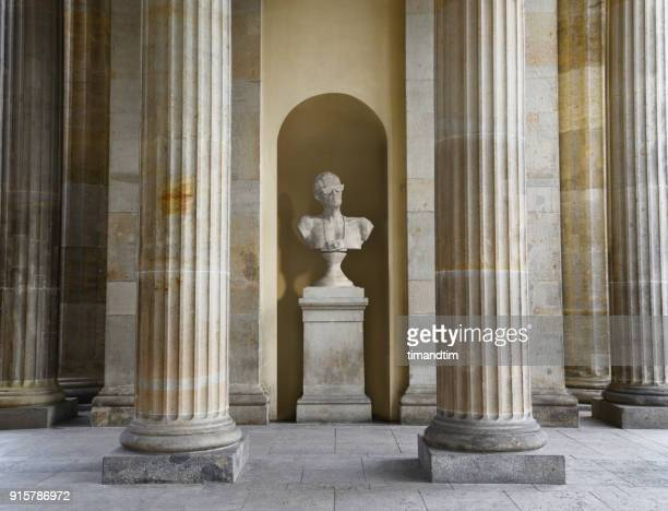 Statue of a tourist on a plinth