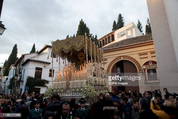 A statue of a Virgin from Favores brotherhood is seen in el Realejo neighborhood during the Good Friday procession in Granada Spain Every year...