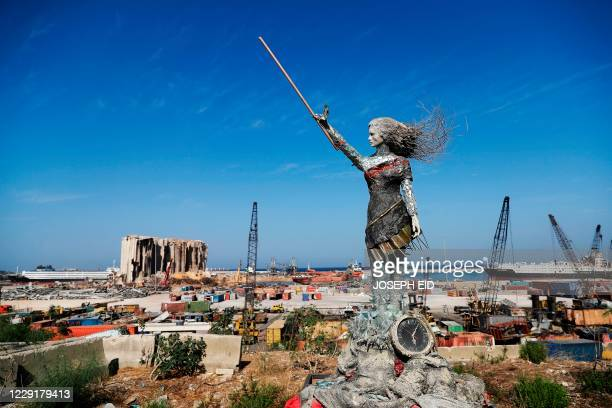 Statue of a woman by Lebanese artist Hayat Nazer, made out of leftover glass, rubble, and a broken clock marking the time of the mega explosion at...