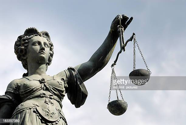 statue of a woman holding a balance scale - lady justice stock pictures, royalty-free photos & images