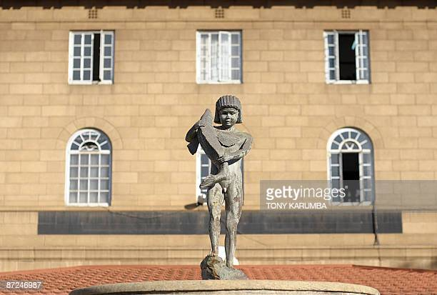 A statue of a young naked boy urinating and holding a fish is pictured outside the Kenyan High court in Nairobi on May 15 2009 As a symbol of justice...