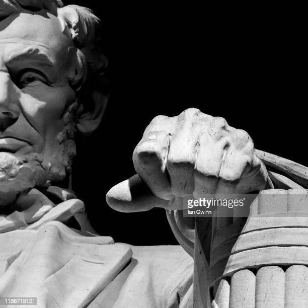 statue of abraham lincoln at lincoln memorial - ian gwinn stock photos and pictures