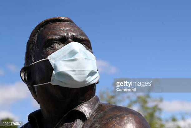 A statue of actor Ronnie Barker is seen wearing a face mask on May 11 2020 in Aylesbury England The prime minister announced the general contours of...
