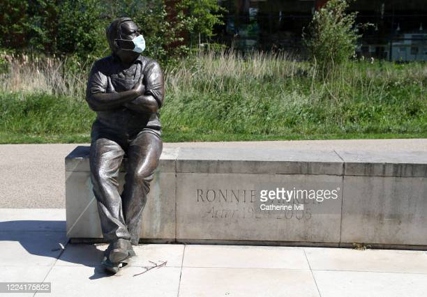 Statue of actor Ronnie Barker is seen wearing a face mask on May 11, 2020 in Aylesbury, England. The prime minister announced the general contours of...