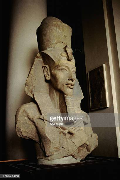 A statue of Akhenaton Amenophis IV and husband of Nefertiti the revolutionary Sun King who tried to convert the polytheistic religion of Egypt to one...