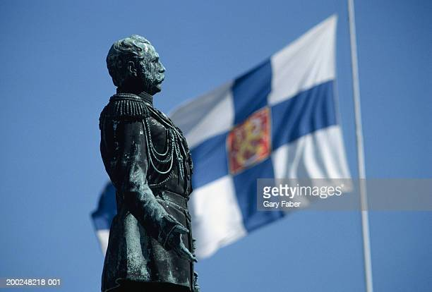 statue of alexander ii, finnish flag in background, helsinki, finland, (close-up) - finnish flag stock photos and pictures
