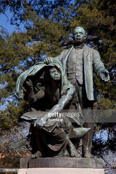 Statue of American Civil Rights leader politician and author Booker T Washington entitled 'Lifting the Veil of Ignorance' on the campus of Tuskegee...