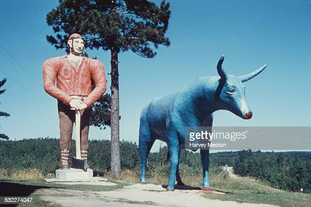 A statue of American folklore lumberjack Paul Bunyan and 'Babe the Blue Ox' in Michigan USA circa 1960