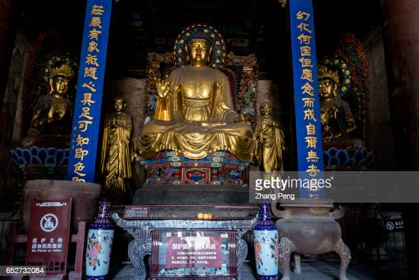 Statue of Amitabha Buddha from Ming Dynasty in the Manichean Hall of the Longxing Temple The Longxing Temple is an ancient Buddhist monastery first...