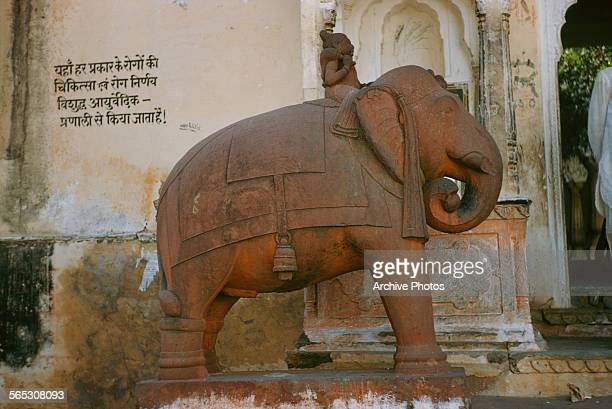 A statue of an elephant and rider in the Red Fort Delhi India circa 1965