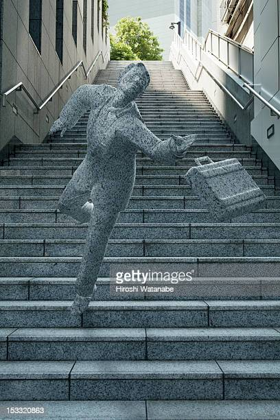 Statue of an overworked businessman