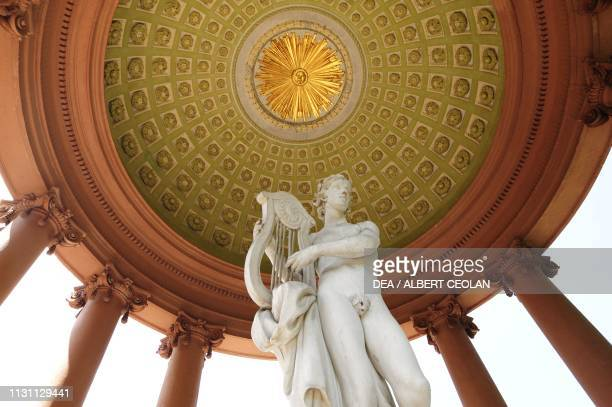 Statue of Apollo playing the lyre and vault of the temple of Apollo garden of the Schwetzingen Castle BadenWurttemberg Germany