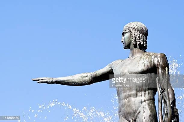 Statue of Apollo-god of music against blue sky, copy space