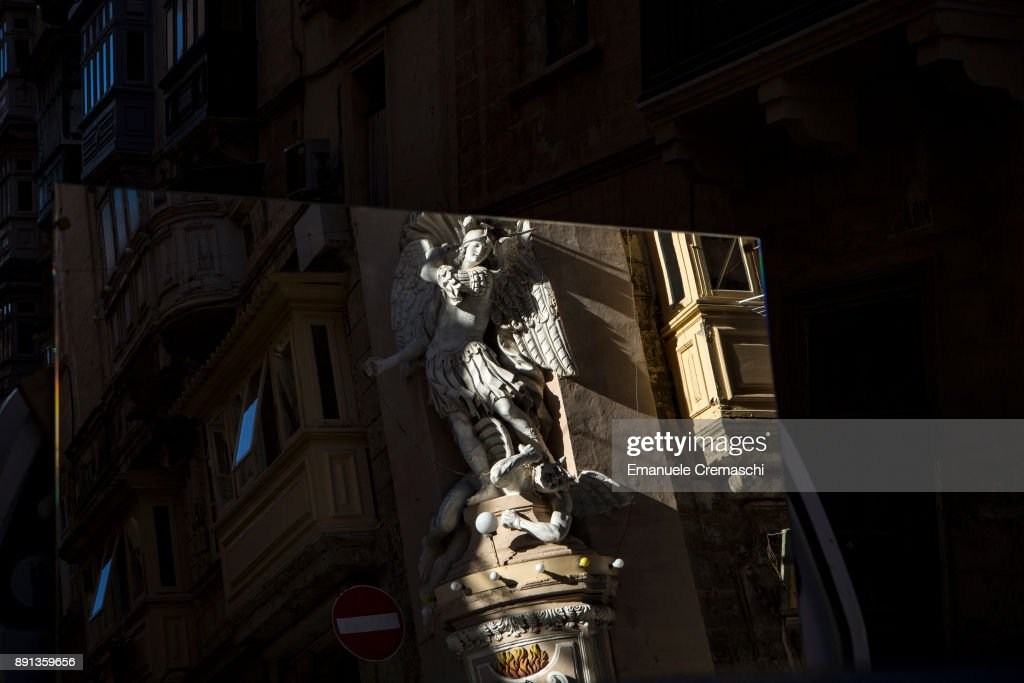 A statue of Archangel Michael is reflected on a mirror on December 8, 2017 in Valletta, Malta. Valletta, a fortified town that dates back to the 16th century, is the southernmost capital of Europe and a UNESCO World Heritage Site: together with all the Maltese islands, it will be hosting the title of European Capital of Culture in 2018.