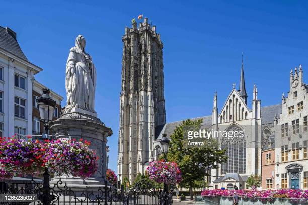 Statue of Archduchess Margaret of Austria and the St. Rumbold's Cathedral in the city Mechelen / Malines, Antwerp, Flanders, Belgium.