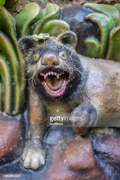A statue of Asian palm civet at Kopi luwak farm and plantation in Ubud District Bali Indonesia on November 20 2018 Kopi luwak is coffee that includes...