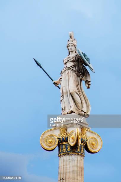 statue of athena atop the university of athens - diosa atenea fotografías e imágenes de stock