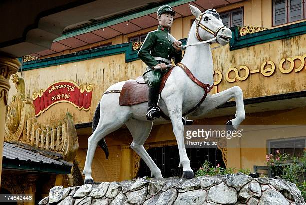 A statue of Aung San the father of Myanmar independence on his horse stands in a courtyard of the Kyakhatwai buddhist pagoda