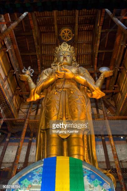 Statue of Avalokitesvara in the Temple of Boddhisattva Avalokiteshvara at the Gandantegchinlen Monastery in Ulaanbaatar Mongolia which is with...