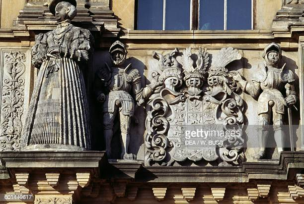 Statue of Barbara of Brandenburg and coats of arms entrance gate to Brzeg castle Opole voivodship Poland 13th16th century
