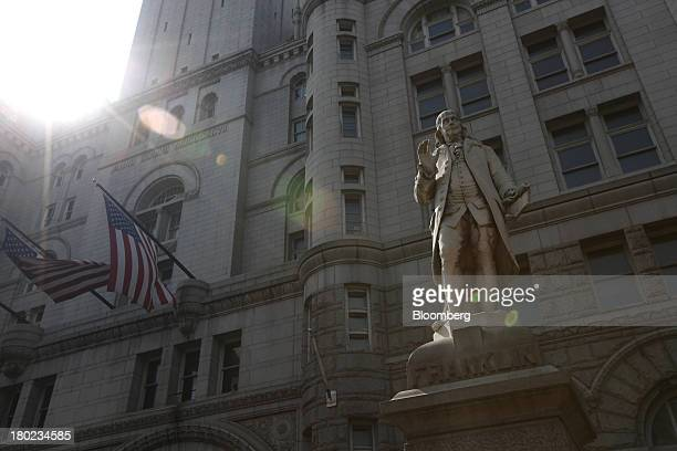 A statue of Ben Franklin stands outside the Old Post Office Pavilion in Washington DC US on Friday Aug 30 2013 Real estate developer Donald Trump...