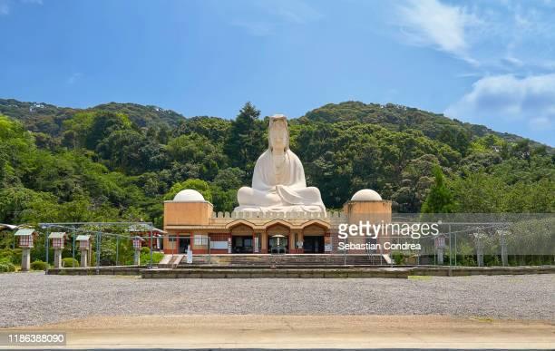statue of bodhisattva avalokiteśvara in the ryozen kannon war memorial, kyoto, japan travel, jr route. - guanyin bodhisattva foto e immagini stock