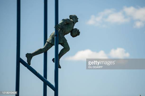 TOPSHOT A statue of Brian Bevan an Australianborn rugby league player by artist Philip Bews outside the Halliwell Jones Stadium the home ground of...