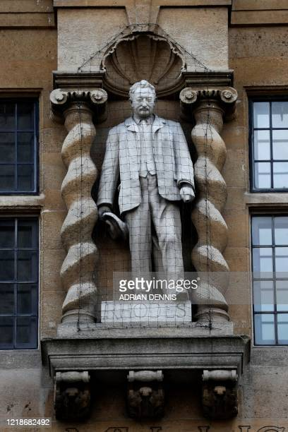 A statue of British businessman and imperialist Cecil John Rhodes is pictured at Oriel College a the University of Oxford on June 9 2020 Following...