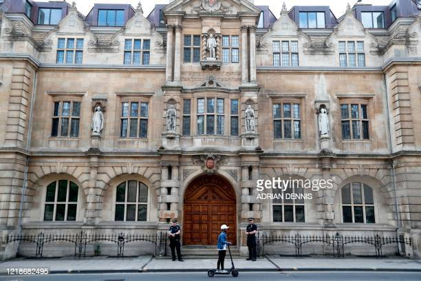 TOPSHOT A statue of British businessman and imperialist Cecil John Rhodes is pictured at Oriel College a the University of Oxford on June 9 2020...