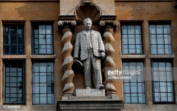 A statue of British businessman and imperialist Cecil John Rhodes is pictured outside Oriel College at the University of Oxford in Oxford west of...
