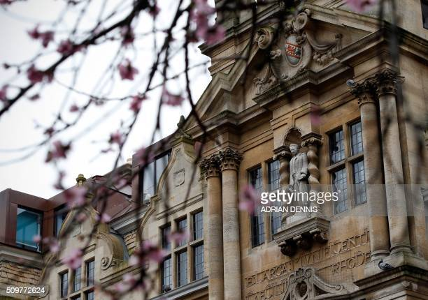A statue of British businessman Cecil Rhodes is seen on the facade of Oriel College in Oxford on February 5 2016 A statue at Oxford University of...