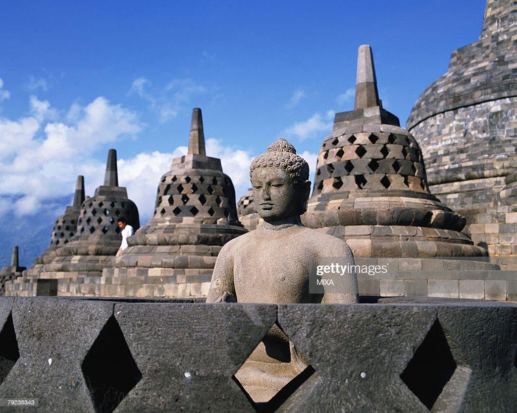 A statue of Buddha in Borobudur Temple, Java, Indonesia : Stock Photo