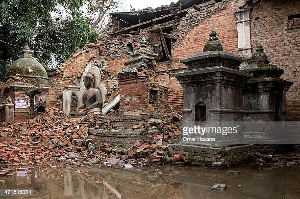 Statue of Buddha is covered by debris from a collapsed temple on April 29, 2015 in Bhaktapur, Nepal. A major 7.8 earthquake hit Kathmandu mid-day on...