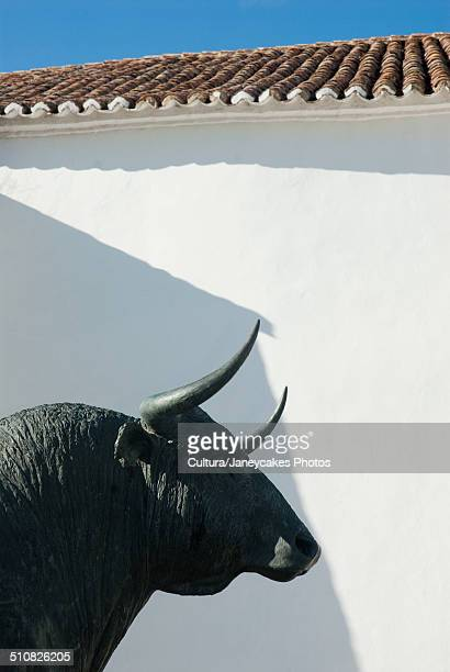 Statue of bull outside building, Malaga, Spain