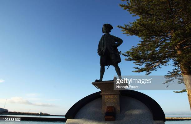 A statue of Captain Cook who discovered New Zealand stands as the sun rises over Watson Park on January 01 2011 in Gisborne New Zealand