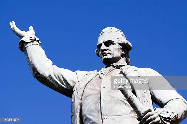 statue of captain james cook against blue sky, copy space - captain cook stock pictures, royalty-free photos & images