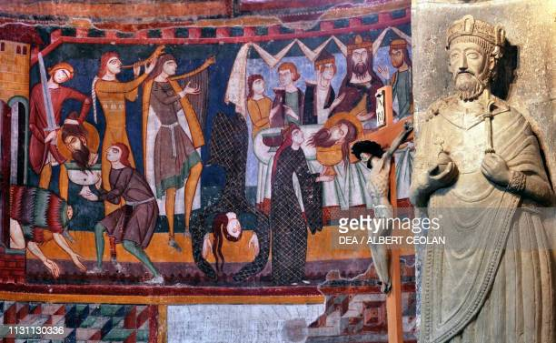 Statue of Charlemagne in stucco, 9th-12th century, and frescoes depicting the life of St John in the apse, interior of the abbey church, Benedictine...