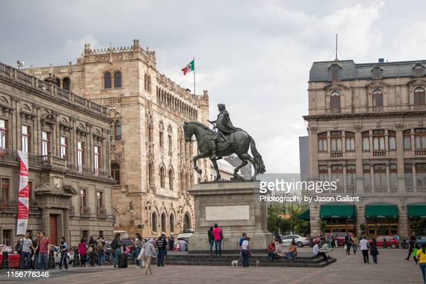 statue of charles iv of spain in the plaza manuel tolsá outside of the museo nacional de arte in mexico city on a rainy day. - museum of contemporary art stock pictures, royalty-free photos & images