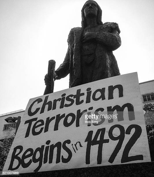 A statue of Christopher Columbus is adorned with a protest sign during the Protest and March Against Columbus Sunday October 12 2014 in Los Angeles