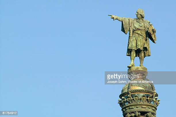 statue of christopher columbus points to the new world - christopher columbus explorer stock photos and pictures
