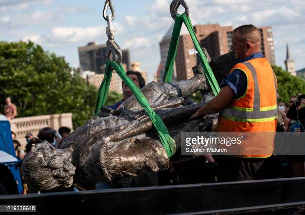 A statue of Christopher Columbus which was toppled by protesters is loaded onto a truck on the grounds of the State Capitol on June 10 2020 in St...