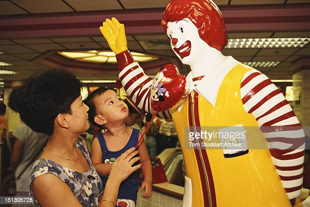 A statue of clown mascot Ronald McDonald at a McDonald's restaurant in Shenzhen China 1993