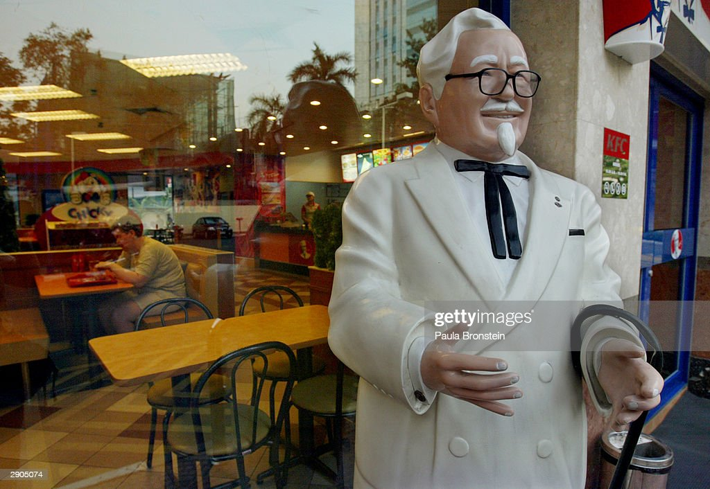A statue of Colonel Harland Sanders, founder of Kentucky Fried Chicken (KFC) stands on the street one of the fast food restaurants in Bangkok, Thailand January 27, 2004. Vietnam announced the closing of 8 outlets in order to change to a fish based menu. An outbreak of Bird Flu has ravaged poultry farms and could devastate the country's chicken export sector which is the worl's fourth largest worth 1.5 billion dollars. The Bird Flu (also called Avian Flu) has claimed six victims in Vietnam and one in Thailand. The World Health organization ( W.H.O.) said there was no evidence of person-to-person spread of the virus.