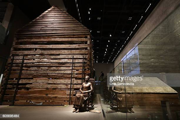 A statue of Colorado pioneer and former slave Clara Brown is on display next to a preserved slave cabin at the Smithsonian's National Museum of...