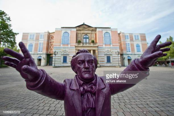 Statue of composer Richard Wagner by artist Ottmar Hoerl is visible in front of the Bayreuth Festival Theatre in Bayreuth, Germany, 23 July 2013. The...