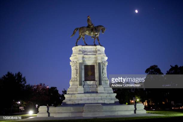 A statue of Confederate commander Robert E Lee stands above a traffic circle on Monument Avenue on October 18 2018 in Richmond Virginia