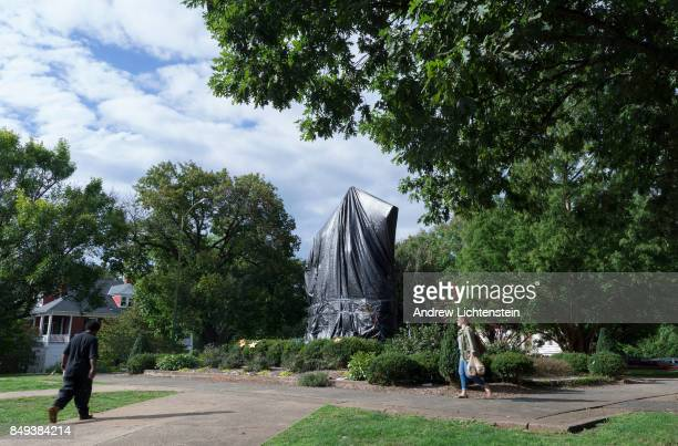 A statue of Confederate general Robert E Lee is covered in plastic on September 14 2017 in downtown Charlottesville Virginia Town officials covered...